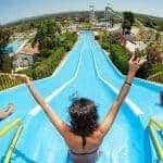 Visitings racing down the high slides at Aqualand