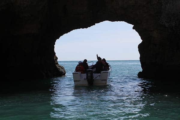 Lagos Grotto Trip boat leaving a cave