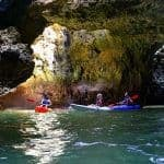 Kayakers venture inside one of the Algarve's famous caves