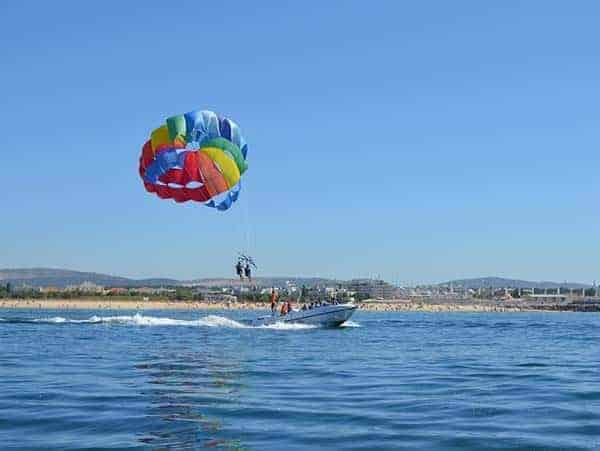 enjoying parasailing at vilamoura