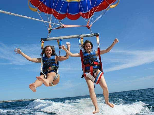 Children enjoying tandem parasailing near Vilamoura