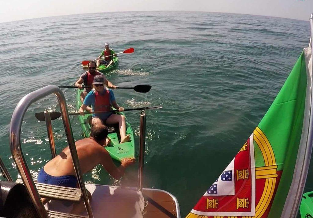 people on kayaks