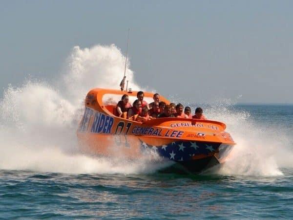Orange Jet Boat carring people