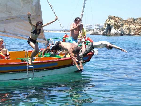 Swim stop with people jumping from the boat - Traditional sailing boat