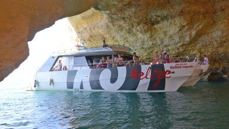 catamaran entering a large cave near Benagil