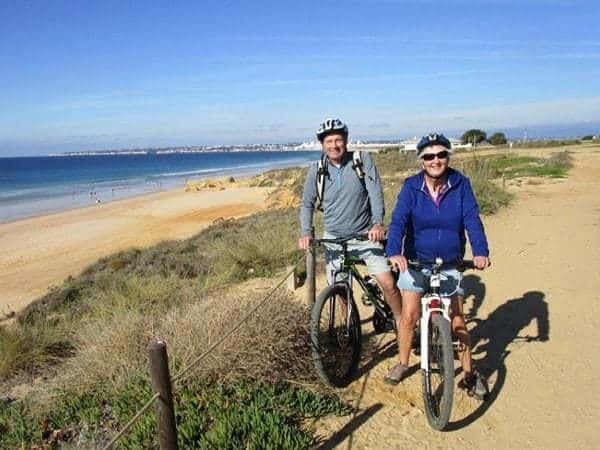 2 people on bike, near the beach, Albufeira.