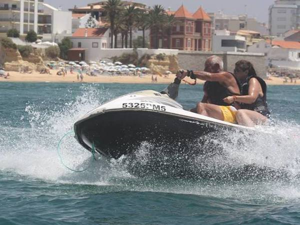 A couple on a Jet ski in Amação de Pera