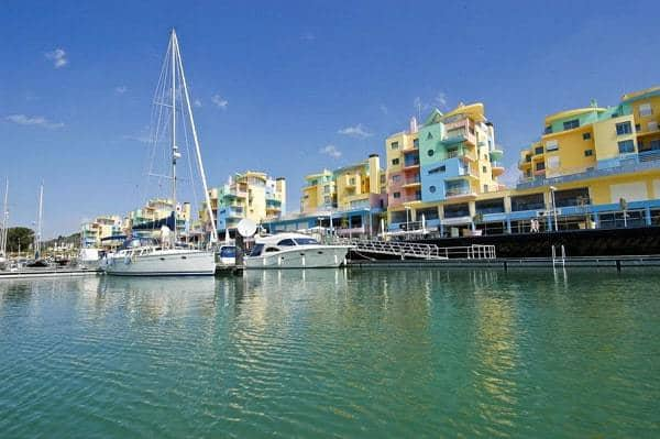 Albufeira marina with sailing boat and colourfull