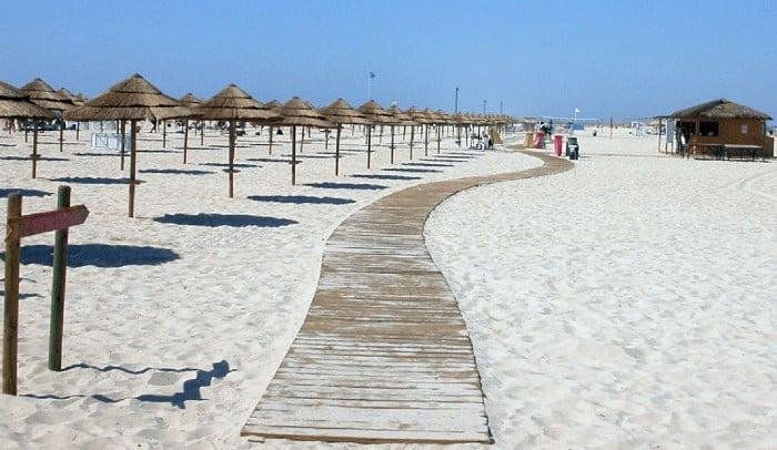Tavira Island with beach umbrellas on the left