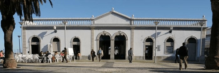 Front of Tavira Market with an outside area and people