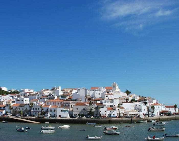white houses and boats in Ferragudo