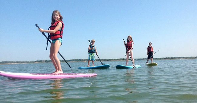 Kids learning Stand Up Paddle