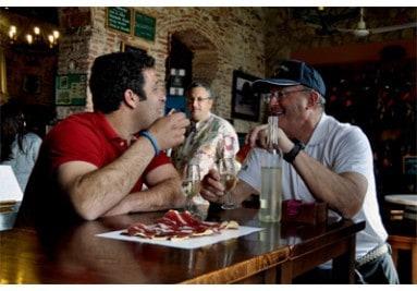 two people enjoying ham at Delicatessen restaurant